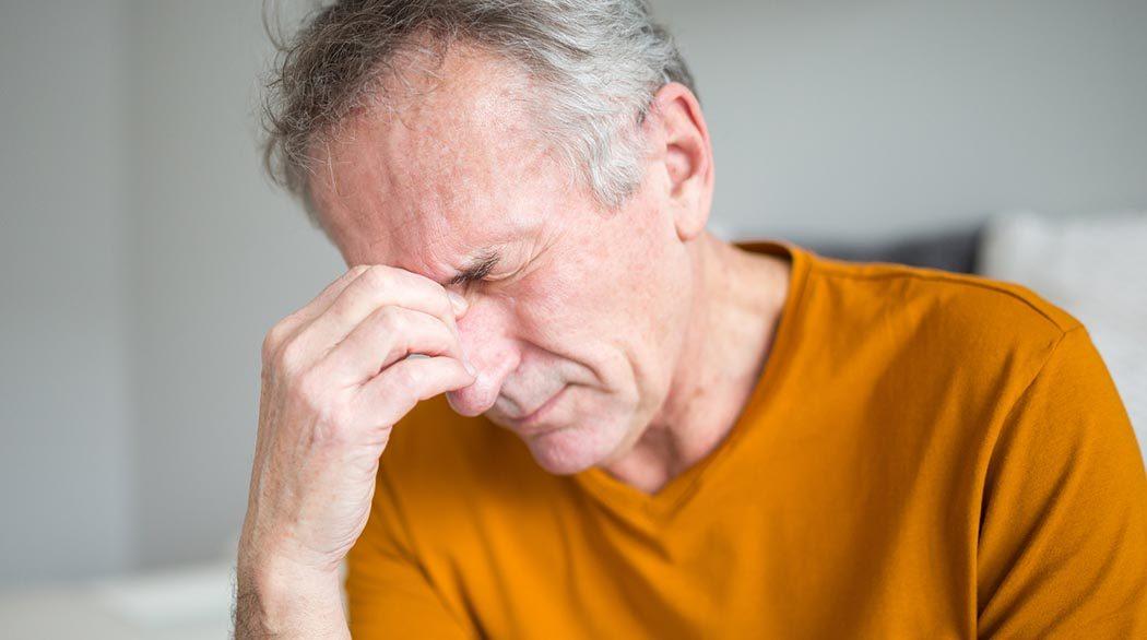man experiencing headache