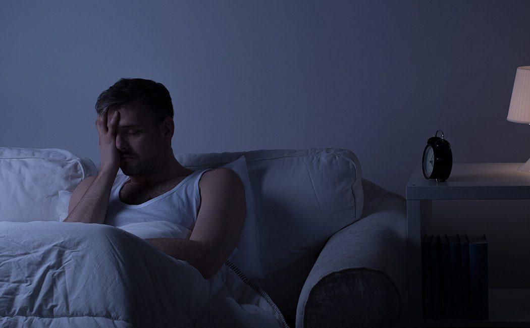 Man with sleep insomnia